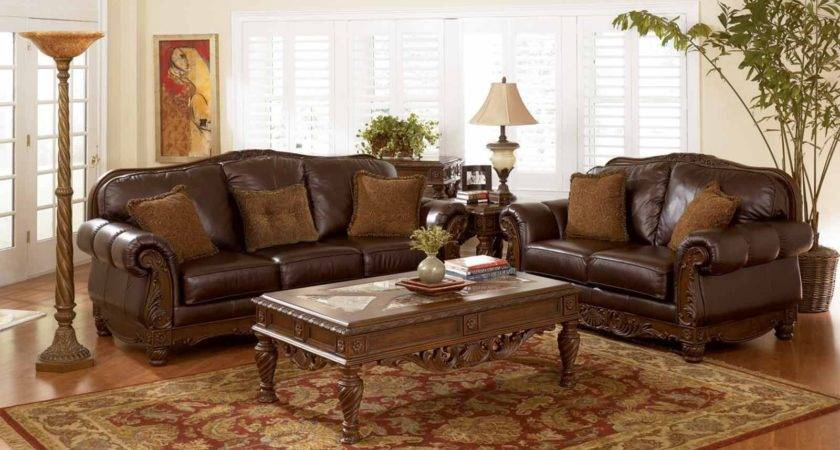 Brown Leather Sofa Orange Cushions Brokeasshome