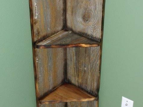 Brown Wooden Five Shelves Leaning White Wall