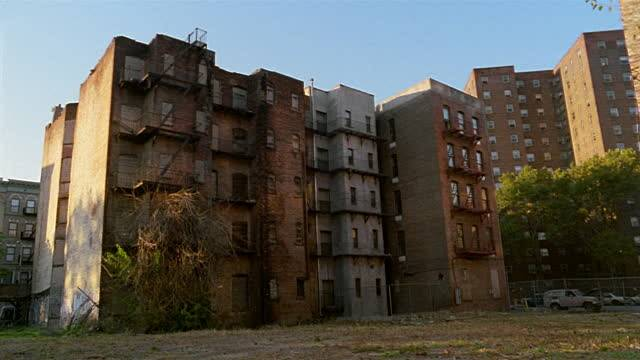Canted Run Down Apartment Buildings Harlem New York