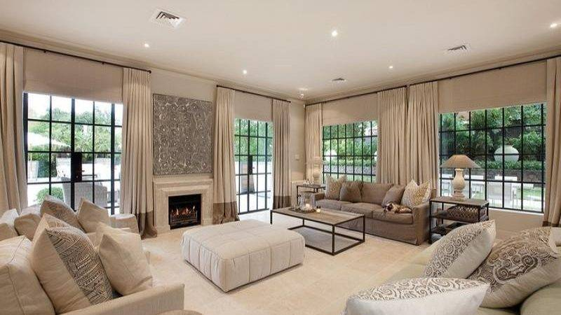 Open Plan Living Room Using Beige Colours Carpet