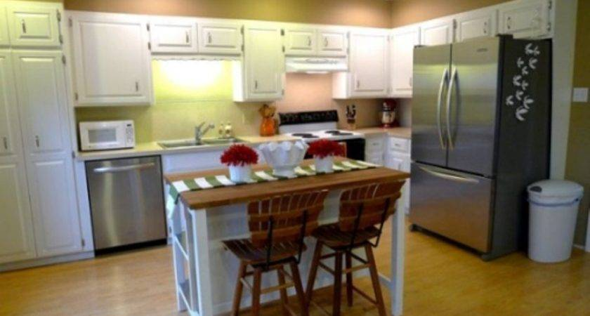 Yellow Wall Color White Cabinet Using Small Island